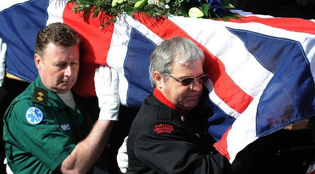 Emergency workers, who were on duty on the night that Pc David Rathband was shot, carry his coffin