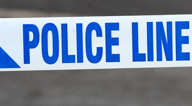 Police arrested three people after the bodies of two women were found in Wakefield