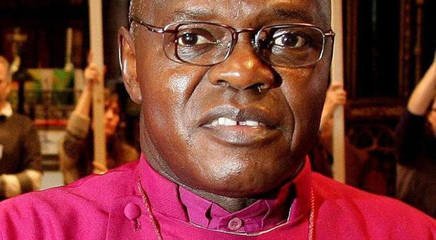 The Archbishop of York Dr John Sentamu has criticised the Government for 'meddling' over whether Christians have the right to wear a cross at work