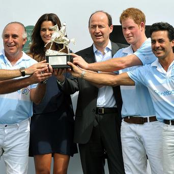 Prince Harry and his polo team, with Brazilian supermodel Fernanda Mutta, receive the Sentabale Cup