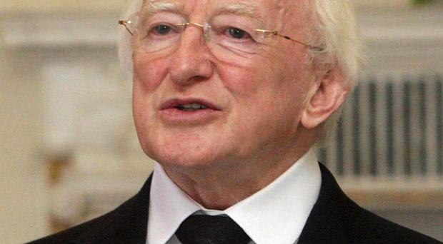 President Michael D Higgins has attended a play put together by 28 inmates at Wheatfield Prison