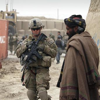 A US soldier on patrol after it was confirmed that another American troop had shot several Afghanistan civilians (AP)