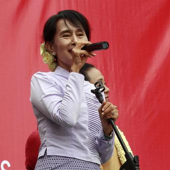 Burmese pro-democracy leader Aung San Suu Kyi has made a plea for the world's press to keep the spotlight on Burma (AP)