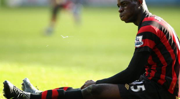 SWANSEA, WALES - MARCH 11: Mario Balotelli of Manchester City reacts after he does not win a foul during the Barclays Premier League match between Swansea City and Manchester City at the Liberty Stadium on March 11, 2012 in Swansea, United Kingdom. (Photo by Scott Heavey/Getty Images)