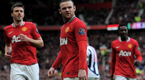 MANCHESTER, ENGLAND - MARCH 11: Wayne Rooney of Manchester United looks on after scoring his team's second goal during the Barclays Premier League match between Manchester United and West Bromwich Albion at Old Trafford on March 11, 2012 in Manchester, England. (Photo by Michael Regan/Getty Images)