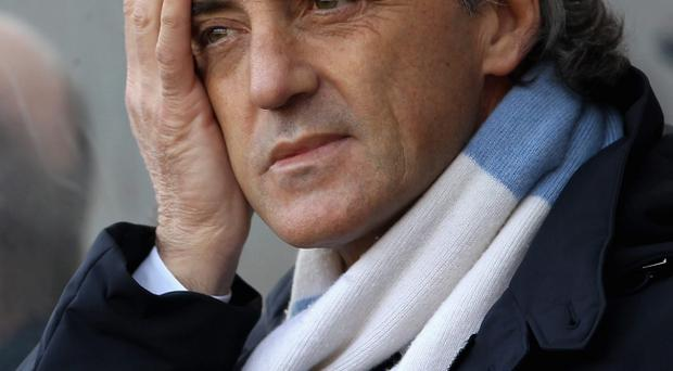 SWANSEA, WALES - MARCH 11: Manchester City manager Roberto Mancini looks thoughtful ahead of the Barclays Premier League match between Swansea City and Manchester City at the Liberty Stadium on March 11, 2012 in Swansea, United Kingdom. (Photo by Scott Heavey/Getty Images)