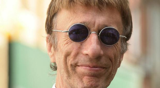 Robin Gibb is in remission after collapsing with colon and liver cancer in 2010