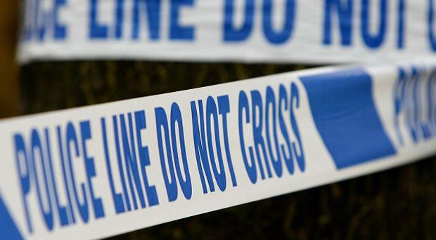 An innocent woman is in hospital after being caught up in a gunfight between two men