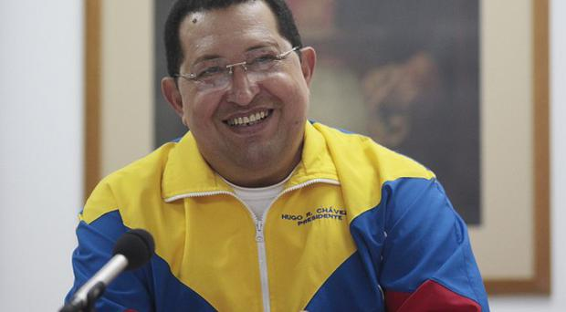 Hugo Chavez smiles during a meeting with his cabinet in Havana, Cuba (AP/Miraflores Press Office)