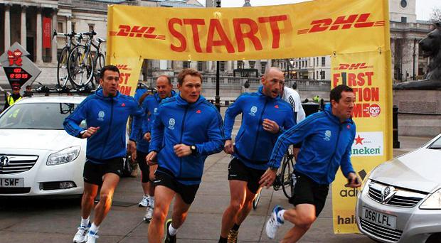 Captain Josh Lewsey (centre) leading out Team England on day one of DHL First Nation Home in Trafalgar Square