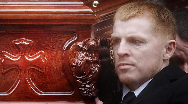 Celtic Manager Neil Lennon carries the coffin of Paul McBride QC following his funeral at St Aloysius' Church in Glasgow Scotland.