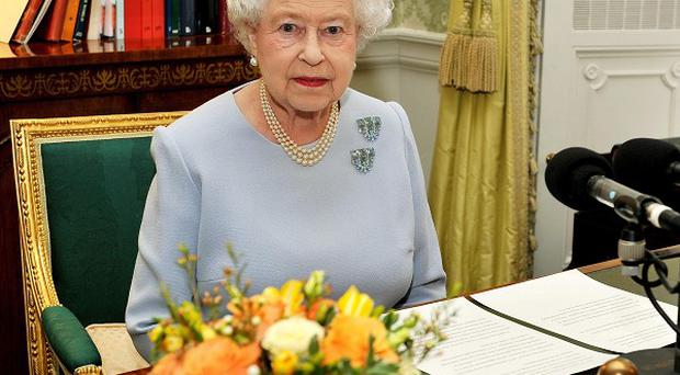 The Queen after recording her Commonwealth Day radio message at Buckingham Palace, London