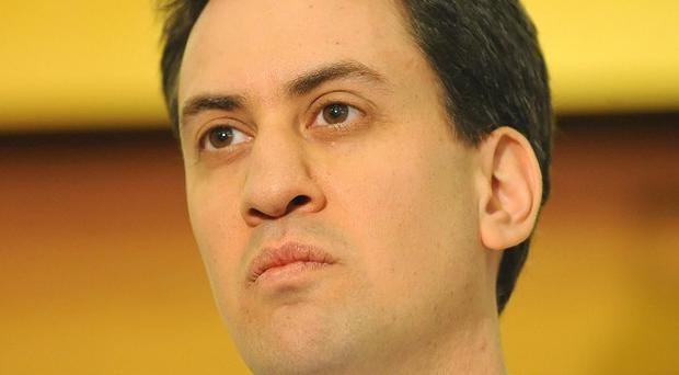 Labour Party leader Ed Miliband was seen at a football match after cancelling a speech due to illness