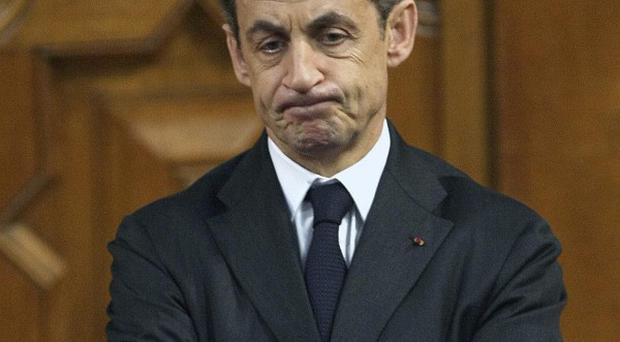 Polls show Nicolas Sarkozy faces a tough battle for re-election in April and May (AP)