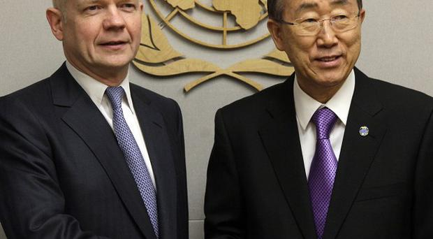 Foreign Minister William Hague with UN secretary general Ban Ki-moon at the beginning of their meeting at United Nations headquarters (AP)