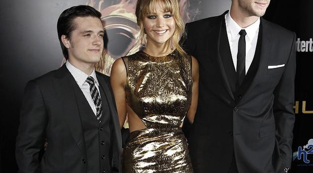 Josh Hutcherson, Jennifer Lawrence and Liam Hemsworth arrive at the world premiere of The Hunger Games in LA (AP)