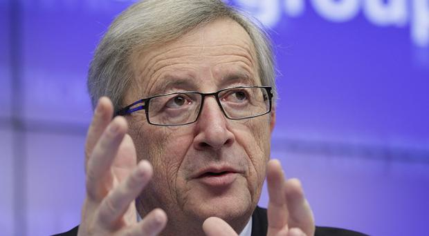 Luxembourg's Prime Minister Jean-Claude Juncker speaks during a media conference after a meeting of eurozone finance ministers in Brussels (AP)