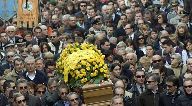 Mourners follow the coffin of Franco Lamolinara at his funeral in Gattinara, northern Italy (AP)