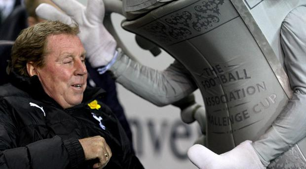 The FA Cup mascot (right) shares a joke with Tottenham Hotspur manager Harry Redknapp