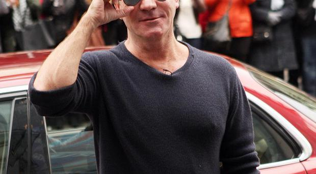 Simon Cowell is bringing Red Or Black? back to TV screens