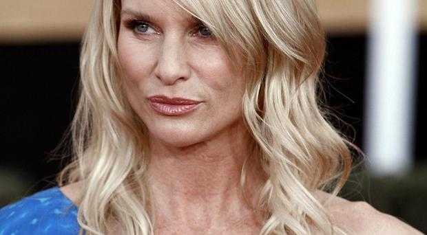 Actress Nicollette Sheridan's legal action over her firing from Desperate Housewives has featured all the kind of conflicts the show thrived on (AP)