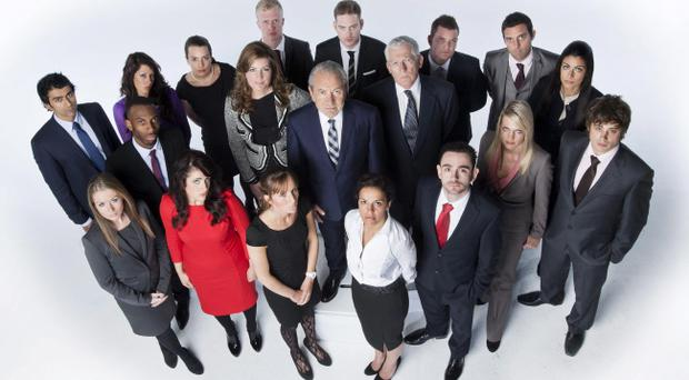 Lord Sugar, centre, Karen Brady, centre left and Nick Hewer, centre right, with the contestants who will take part in the next series of The Apprentice