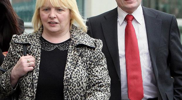 Sally Gribben, sister of Martin McCaughey, and Philip O'Neill, brother in law of Dessie Grew, outside Laganside Court in Belfast
