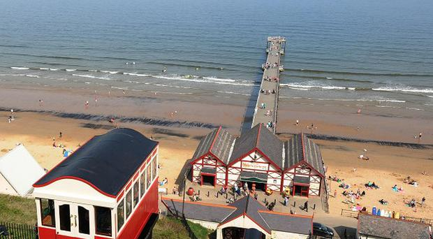Armed police have sealed off the sea front at Saltburn over concerns for a woman's welfare