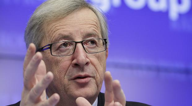 Jean-Claude Juncker said it was 'of the utmost importance' that Spain brought its deficit down (AP)