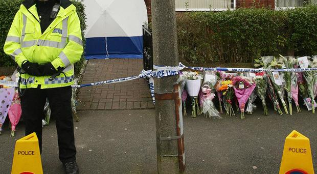 Floral tributes left near to the scene in Droylsden where Leanne McNuff, 24, was found stabbed