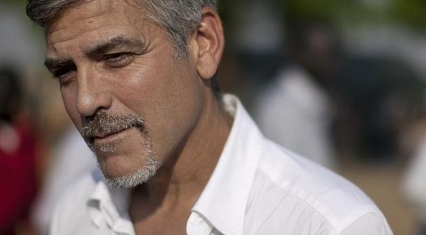 Actor George Clooney has secretly visited the dangerous and troubled border region between Sudan and South Sudan (AP)