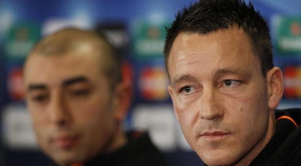 Chelsea's caretaker manager Roberto Di Matteo, left, and player John Terry during a press conference at Stamford Bridge Stadium in London, Tuesday, March 13, 2012. Chelsea will play Napoli at the stadium on Wednesday, in a Champions League second leg soccer match