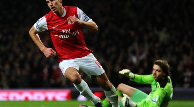 LONDON, ENGLAND - MARCH 12: Robin van Persie of Arsenal celebrates scoring their first goal during the Barclays Premier League match between Arsenal and Newcastle United at Emirates Stadium on March 12, 2012 in London, England. (Photo by Mike Hewitt/Getty Images)