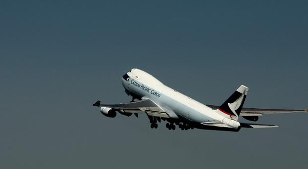 Cathay Pacific Airways' profits fell more than sixty per cent last year