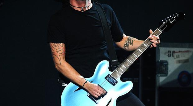 The Foo Fighters will headline this year's Reading and Leeds Festivals along with The Cure and Kasabian