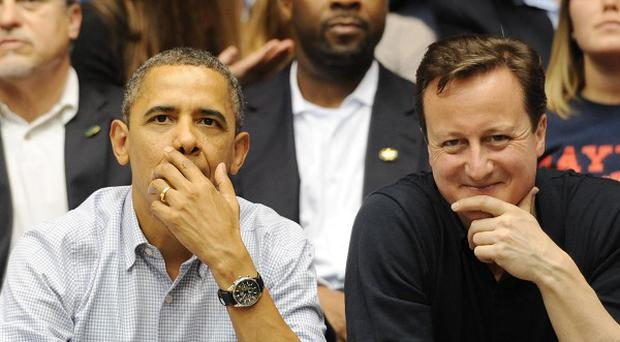 Prime Minister David Cameron and US president Barack Obama enjoy a college basketball match in Ohio
