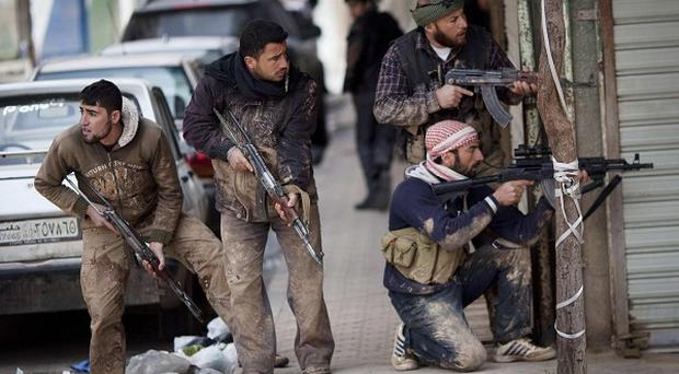 Amnesty International said the current violence in Syria resembled the 'nightmare' of the country during the 1970s and 1980s (AP)