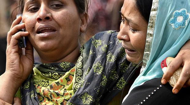 A Bangladeshi woman cries near the body of her relative, victim of the ferry accident