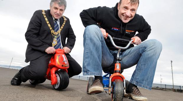 Mayor of Coleraine, Alderman Maurice Bradley chases down road race star Bruce Anstey as they launch Coleraine Borough Council's Race Week festival