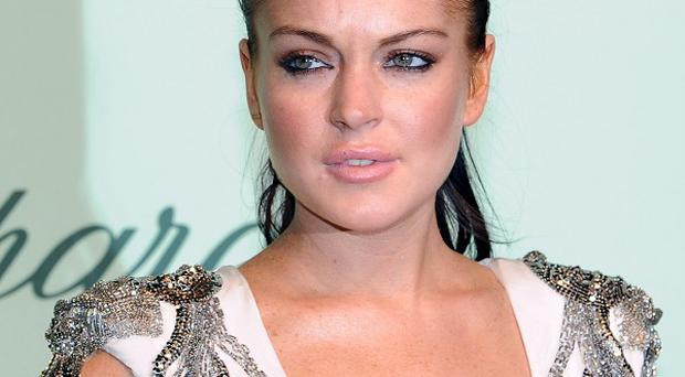A man has claimed that Lindsay Lohan's car grazed his knee
