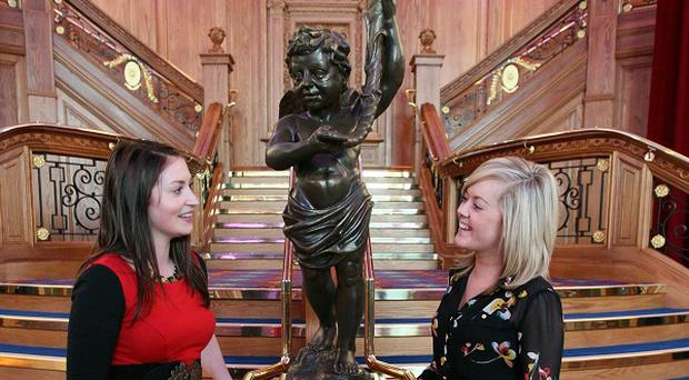 Invited guests stand beside a replica of the Titanic staircase