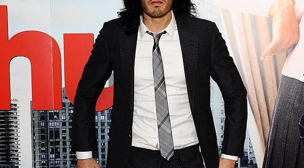 Russell Brand allegedly smashed an office window with a photographer's phone