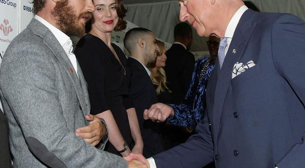 The Prince of Wales speaks with Tom Hardy during The Prince's Trust and L'Oreal Paris Celebrate Success Awards