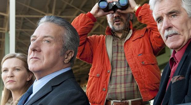 Joan Allen, Dustin Hoffman, John Ortiz and Dennis Farina in a scene from the TV drama Luck, which HBO has cancelled after horses died