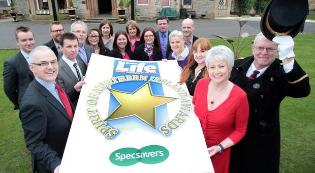 Big Launch: Frank Mitchell, Pamela Ballentine, Sunday Life Editor Martin Breen and Specsavers representatives at the Culloden Estate and Spa