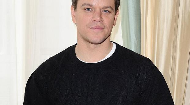 Matt Damon has his fingers crossed that his new movie does well