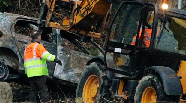 The bodies of two men found in a burnt-out car have been identified
