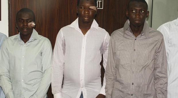 Suspected Boko haram sect members are paraded before the media in Abuja, Nigeria (AP)
