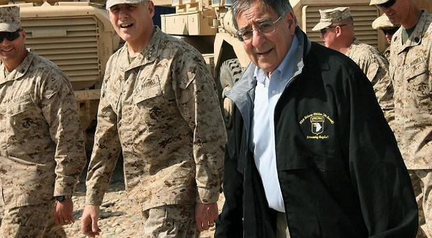 US defence secretary Leon Panetta visits with troops at Forward Operating Base Shukvani, Afghanistan (AP)