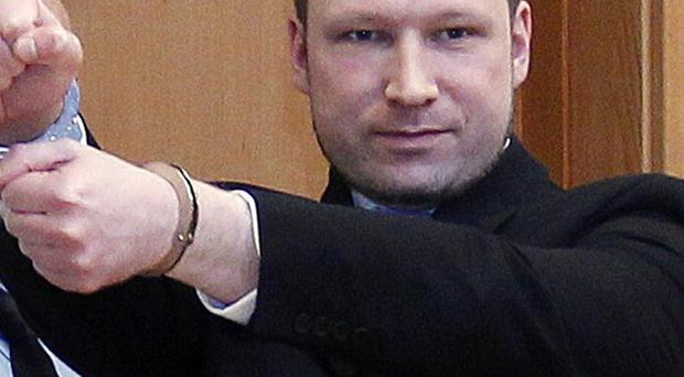 Norwegian police admit they were too slow to react to the massacre by Anders Behring Breivik last summer(AP)